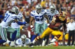 Clinton Portis (26) of the Washington Redskins runs the ball during the NFL season opener against the Dallas Cowboys at FedExField on September 12, 2010 in Landover, Maryland. The Redskins defeated the Cowboys 13-7. Larry French/Getty Images