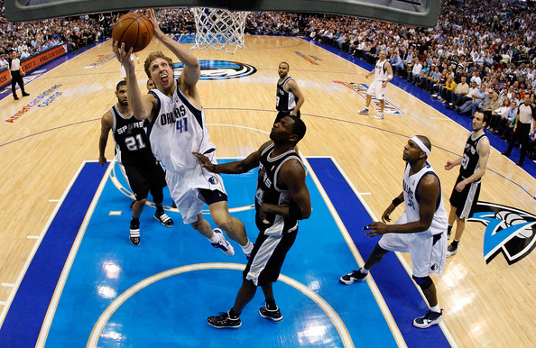 Forward Dirk Nowitzki #41 of the Dallas Mavericks takes a shot against Antonio McDyess #34 of the San Antonio Spurs in Game Five of the Western Conference Quarterfinals during the 2010 NBA Playoffs at American Airlines Center on April 27, 2010 in Dallas, Texas. Ronald Martinez .....