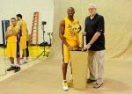 Kobe Bryant (24) and head coach Phil Jackson of the Los Angeles Lakers pose with NBA Finals Larry O'Brien Championship Trophy as teammate Anthony Rob erson #0 looks on during Media Day at the Toyota Center on September 25, 2010 in El Segundo, California. Photo by Kevork Djansezian/Getty Images