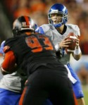 Landover Md , Quarterback (11) Kellen Moore of the Boise State Broncos looks to pass the ball as defensive end (93) Kwamaine Battle of the Virginia Tech Hokies is blocked at FedExField on September 6, 2010 in Landover, Maryland. Getty Images/ Geoff Burke ........