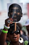 A ticketed guest holds up the face of LeBron James before Chris Bosh (1), Dwyane Wade (3) and LeBron James (6) of the Miami Heat are presented to fans during a welcome party at American Airlines Arena on July 9, 2010 in Miami, Florida. Getty Images/ Doug Benc