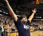 Dallas Mavericks' owner Mark Cuban is seen here at the American Airlines Arena in Dallas Texas at a Mavericks' game leading the home crowd in a cheer . Getty Images / Megan Pryce