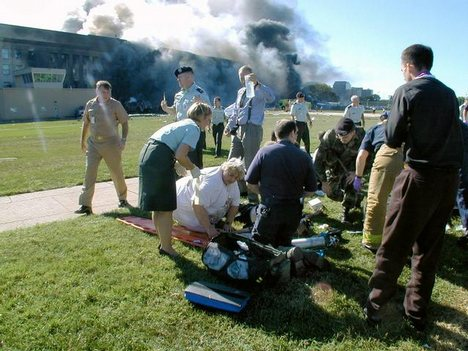Comfort and medical assistance is given to those survivors at the Pentagon Building after a plane is flown directly in the Defense Department Headquarters. Chris Sommerville @ copyrighted material all rights reserved