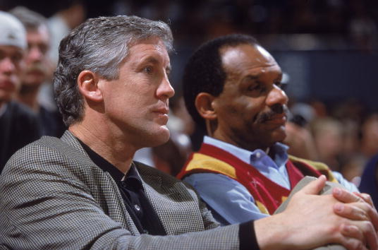 Former Trojan's head football coach Pete Carroll of USC Trojans sits with then Athletic Director Mike Garrett during the game between Arizona Wildcats and USC Trojans at the Los Angeles Sports Arena in Los Angeles, California. The Wildcats defeated the Tojans 105-61. Event dates back to 2001. Stephen Dunn Getty Images /Allsport