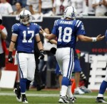 Quarterback Peyton Manning (18) of the Indianapolis Colts gestures to wide receiver Austion Collie (17) after a change of possession against the Houston Texans at Reliant Stadium on September 12, 2010 in Houston, Texas. Bob Levey/Getty Images