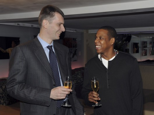 Mikhail Prokhorov (left) the majority stakeholder and owner of the New Jersey Nets is seen here with minority investor and stakeholder in the team _ rapper Jay Z. The two are hoping for renewed success for the franchise. Prokhorov has stated that it is his intention to make the NBA franchise a worldwide success on a global scale . His plan is to make the team a perennial contender with the hope of winning an NBA title within the next five years. Getty Images/ Fernando Jiminez