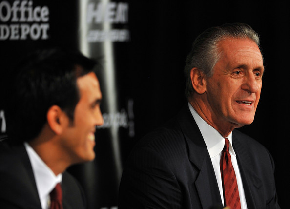 Head coach Erik Spoelstra (L) and President Pat Riley (R) of the Miami Heat talk during a press conference after a welcome party for new teammates LeBron James, Dwyane Wade, and Chris Bosh at American Airlines Arena on July 9, 2010 in Miami, Florida. Getty Images / Doug Benc .....