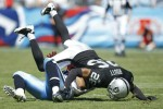 Stanford Routt (26) of the Oakland Raiders tackles Bo Scaife (80) of the Tennessee Titans during the NFL season opener at LP Field on September 12, 2010 in Nashville, Tennessee. The Titans defeated the Raiders 38-13. Joe Robbins/Getty Images