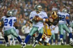 Tony Romo (9) of the Dallas Cowboys looks to pass during the NFL season opener against the Washington Redskins at FedExField on September 12, 2010 in Landover, Maryland. Larry French/Getty Images