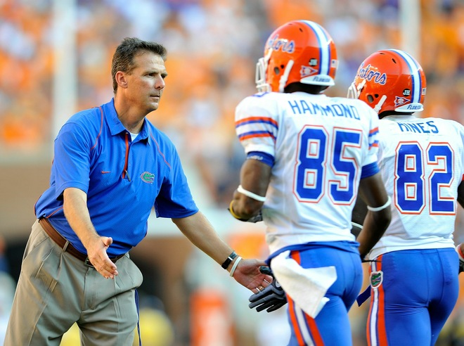 Coach Urban Meyer of the Florida Gators congratulates his players after scoring a touchdown against the Tennessee Volunteers at Neyland Stadium on September 18, 2010 in Knoxville, Tennessee. Getty Images / Grant Halverson