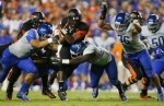 Quarterback Tyrod Taylor of the Virginia Tech Hokies is tackled by defensive end (40) Tyrone Crawford, linebacker (33) Tommy Smith, and linebacker Aaron Tevis of the Boise State Broncos at FedExField on September 6, 2010 in Landover, Maryland. Getty Images/ Geoff Burke ..........