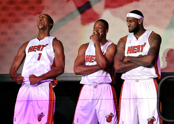 Chris Bosh #1, Dwyane Wade #3, and LeBron James #6 of the Miami Heat are introduced to fans during a welcome party at American Airlines Arena on July 9, 2010 in Miami, Florida. Getty Images / Doug Benc