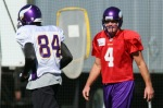 Eden Prairie , Mn ; Wide receiver Randy Moss (8)4 of the Minnesota Vikings runs past quarterback Brett Favre (4) while taking his first practice after re-joining the Vikings at Winter Park on October 7, 2010 in Eden Prairie, Minnesota. Photo by Adam Bettcher/Getty Images ....