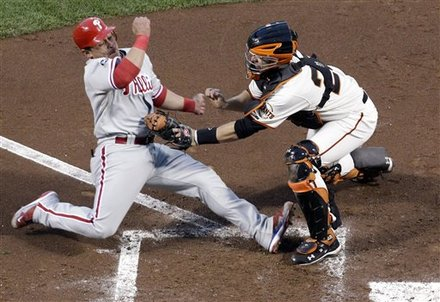 San Francisco Giants catcher Buster Posey tags out Philadelphia Phillies' Carlos Ruiz during the fifth inning of Game 4 of baseball's National League Championship Series Wednesday, Oct. 20, 2010, in San Francisco. Ruiz tried to score from second on a hit by Shane Victorino. AP Photo/David J. Phillip .........