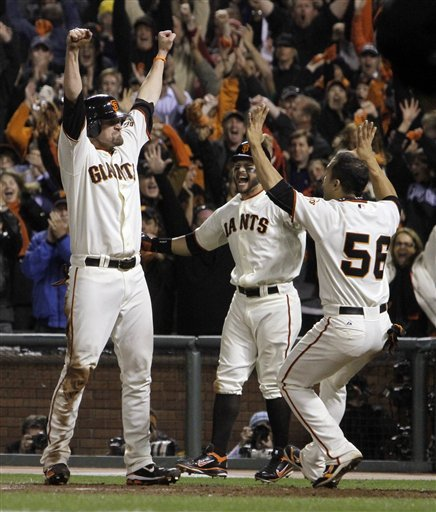 San Francisco Giants' Aubrey Huff reacts with teammates Cody Ross and Andres Torres, right, after scoring from third on a sacrifice fly by Juan Uribe during the ninth inning of Game 4 of baseball's National League Championship Series against the Philadelphia Phillies Wednesday, Oct. 20, 2010, in San Francisco. The Giants won to 6-5 to take a 3-1 lead in the series. AP Photo/Jeff Chiu .....