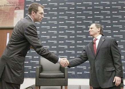 Cleveland Cavaliers owner Dan Gilbert, right, shakes hands with his new general manager Chris Grant at a press availability at the Cleveland Clinic Courts in Independence, Ohio on Tuesday, June 8, 2010. AP Photo/Amy Sancetta ..........