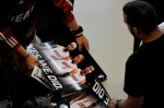 A fan is given a poster of Chris Bosh #1, Dwyane Wade #3 and LeBron James #6 of the Miami Heat before the start of a welcome party at American Airlines Arena on July 9, 2010 in Miami, Florida. Getty Images/ Doug Benc .......