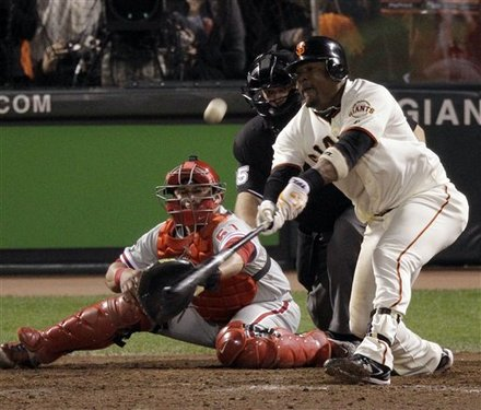 San Francisco Giants' Juan Uribe hits a game-winning sacrifice fly during the ninth inning of Game 4 of baseball's National League Championship Series against the Philadelphia Phillies Wednesday, Oct. 20, 2010, in San Francisco. The Giants won to 6-5 to take a 3-1 lead in the series. AP Photo/Marcio Jose Sanchez .......
