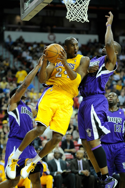 Kobe Bryant (24) of the Los Angeles Lakers drives between Antoine Wright (3) (l) and Carl Landry (24) of the Sacramento Kings during their preseason game at the Thomas & Mack Center October 13, 2010 in Las Vegas, Nevada. Photo by Ethan Miller/Getty Images .....