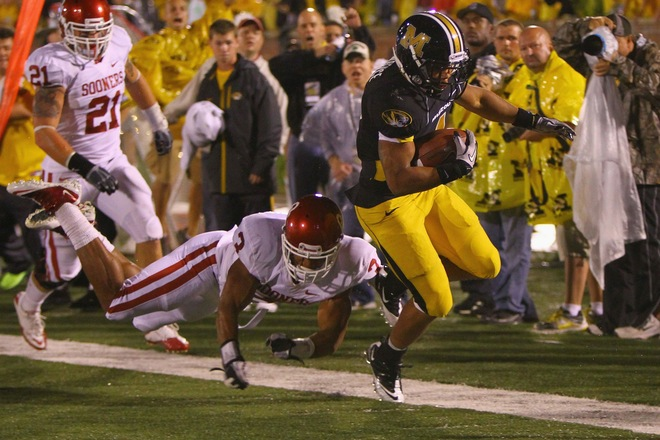 Kendial Lawrence (4) of the Missouri Tigers gets past Jonathan Nelson (3) of the Oklahoma Sooners at Faurot Field/Memorial Stadium on October 23, 2010 in Columbia, Missouri. The Tigers beat the Sooners 36-27. Photo by Dilip Vishwanat/Getty Images ......