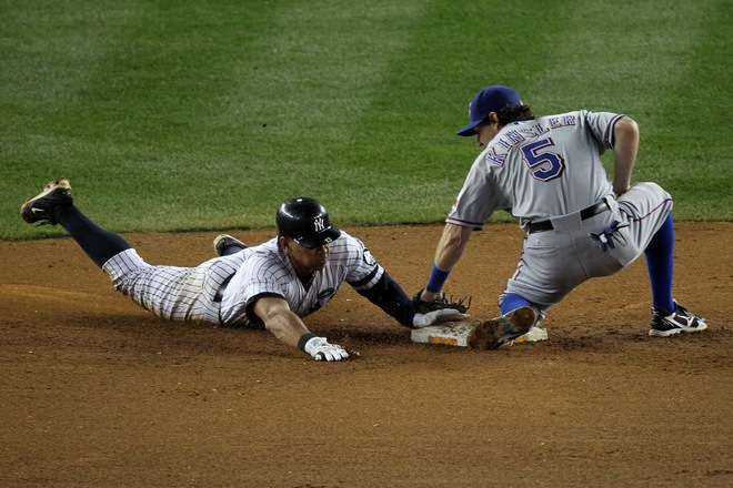 Alex Rodriguez of the New York Yankees successfully steals second base against Ian Kinsler (5) of the Texas Rangers in Game Five of the ALCS during the 2010 MLB Playoffs at Yankee Stadium on October 20, 2010 in the Bronx borough of New York City. Photo by Nick Laham/Getty Images ............
