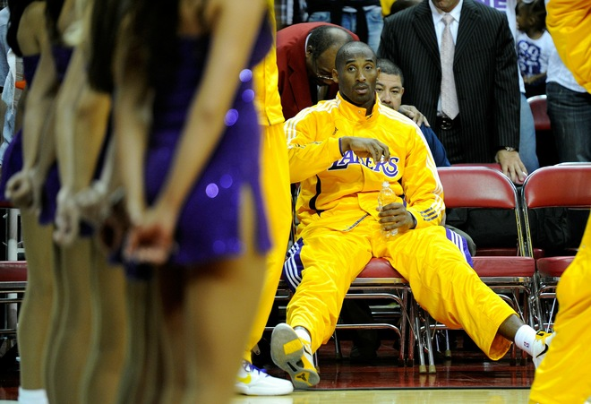 Kobe Bryant (24) of the Los Angeles Lakers waits to be introduced before a preseason game against the Sacramento Kings at the Thomas & Mack Center October 13, 2010 in Las Vegas, Nevada. The Lakers won 98-95. Photo by Ethan Miller/Getty Images