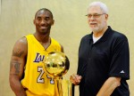 Kobe Bryant #24 and head coach Phil Jackson of the Los Angeles Lakers pose with NBA Finals Larry O'Brien Championship Trophy during Media Day at the Toyota Center on September 25, 2010 in El Segundo, California. Photo by Kevork Djansezian/Getty Images North America