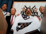 Abe Pollin sells Caps AOL executive Ted Leonsis, second from right, Jon Ledecky, right, and Dick Patrick, left, hold up Washington Capitals jerseys at a news conference Wednesday, May 12, 1999, at the MCI Center in Washington. Wednesday, May 12, 1999, at the MCI Center in Washington Leonsis heads an investment group, including Patrick and Ledecky, which purchased the Washington Capitals NHL team from Abe Pollin, second from left. TWP/ Dayna Smith ..............