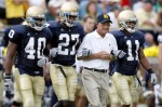 Former head coach Lou Holtz of the Notre Dame Fighting Irish walks out for the coin toss with David Grimes #11, David Bruton #27 and Maurice Crum #40 prior to playing the Michigan Wolverines on September 13, 2008 at Notre Dame Stadium in South Bend, Indiana. Getty Images/ Gregory Shamus .....