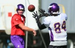 Wide receiver Randy Moss (84) of the Minnesota Vikings catches a ball thrown by Brett Favre (4) during his first practice after re-joining the Vikings at Winter Park on October 7, 2010 in Eden Prairie, Minnesota. Photo by Adam Bettcher/Getty Images ....