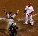 San Francisco Giants catcher Buster Posey celebrates after home plate umpire Tom Hallion calls strike three on Philadelphia Phillies' Ryan Howard to end the ninth inning of Game 6 of baseball's National League Championship Series Sunday, Oct. 24, 2010, in Philadelphia. The Giants won 3-2 to win the series and advance to the World Series against the Texas Rangers. AP Photo/Matt Slocum ...........