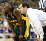 LaceDarius Dunn of Baylor and coach Scott Drew talk during a break in the action against Duke during the second half of their loss, in which an emotional Dunn scored 22 points. Greg Bridges/ MCT ..........