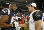 Foxboro' Ma,. Stephen Neal (61) of the New England Patriots congratulates Sam Bradford #8 of the St. Louis Rams after the game on August 26, 2010 at Gillette Stadium in Foxboro, Massachusetts. The Rams defeated the Patriots 36-35. Photo by Elsa/Getty Images ......