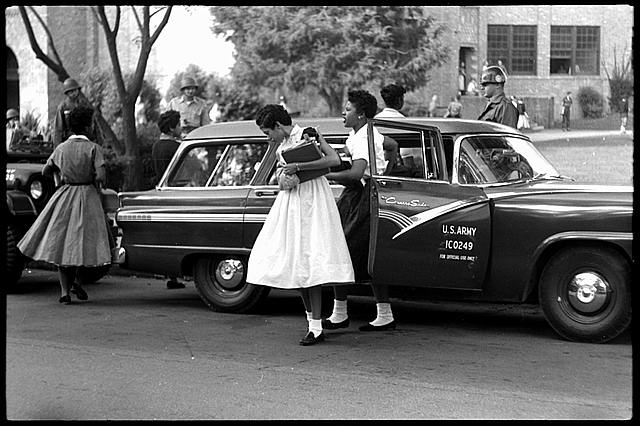 Central High School, Little Rock, Arkansas; African American students arriving in a U.S. Army car. Sourced content Library of Congress