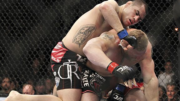 In a matter of 4 minutes and 12 seconds, Brock Lesnar's title reign was over and Cain Velasquez became the sport's first heavyweight champion of Mexican descent. courtesy of ESPN.com/ Ed Mulholland ....... @ copyrighted material all rights reserved