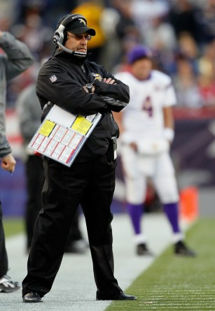 Foxboro Ma,. Coach Brad Childress and Brett Favre (4) of the Minnesota Vikings (rear) watch the action against the New England Patriots at Gillette Stadium on October 31, 2010 in Foxboro, Massachusetts. Photo by Jim Rogash/Getty Images .....