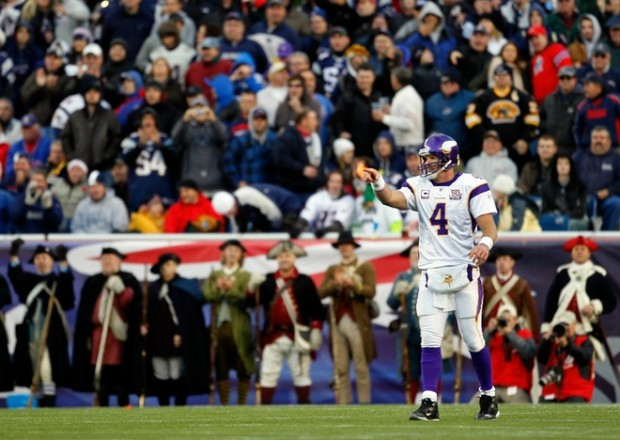Brett Favre (4) of the Minnesota Vikings gestures against the New England Patriots at Gillette Stadium on October 31, 2010 in Foxboro, Massachusetts. Photo by Jim Rogash/Getty Images