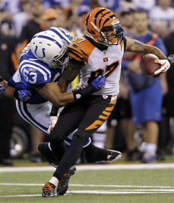Cincinnati Bengals wide receiver Andre Caldwell, right, is tackled for a loss by Indianapolis Colts linebacker Kavell Conner on a reverse play in the first quarter of an NFL football game in Indianapolis, Sunday, Nov. 14, 2010. AP Photo/Michael Conroy ....