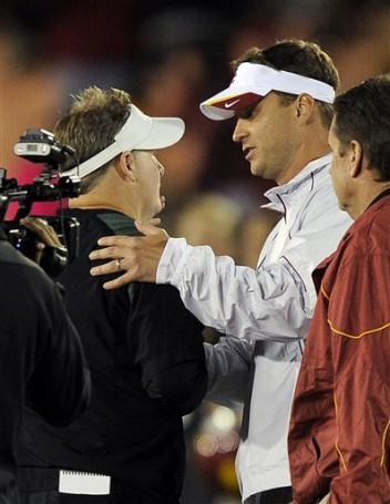 Oregon head coach Chip Kelly, left, is congratulated by Southern California head coach Lane Kiffin after an NCAA college football game, Saturday, Oct. 30, 2010, in Los Angeles. Oregon won 53-32 . AP Photo/Mark J. Terrill .......
