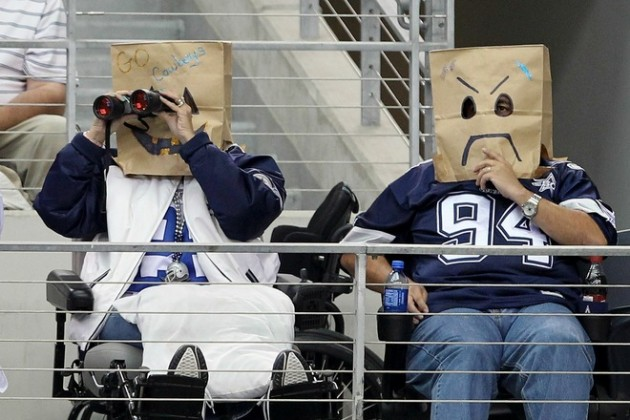 Fans of the Dallas Cowboys wear brown paper bags over their head as they watch the Cowboys play against the Jacksonville Jaguars at Cowboys Stadium on October 31, 2010 in Arlington, Texas. Photo by Chris Chambers/Getty Images