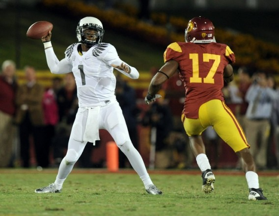 Darron Thomas (1) of the Oregon Ducks passes in front of Michael Morgan (17) of the USC Trojans during the second quarter at Los Angeles Memorial Coliseum on October 30, 2010 in Los Angeles, California. Photo by Harry How/Getty Images .......