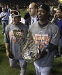 San Francisco Giants' Andres Torres, left, walks with Edgar Renteria and the World Series trophy after winning baseball's World Series against the Texas Rangers Monday, Nov. 1, 2010, in Arlington, Texas. The Giants won 3-1 to capture the World Series. AP Photo/David J. Phillip .......