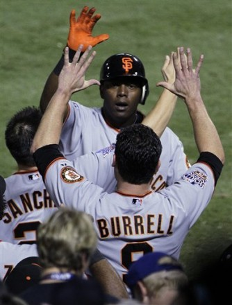 San Francisco Giants' Edgar Renteria, right, is congratulated by Pat Burrell after Renteria hit a three-run home run during the seventh inning of Game 5 of baseball's World Series against the Texas Rangers Monday, Nov. 1, 2010, in Arlington, Texas. AP Photo/Tony Gutierrez ........