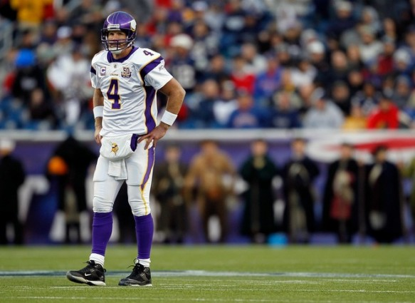Brett Favre #4 of the Minnesota Vikings takes a breather between plays against the New England Patriots at Gillette Stadium on October 31, 2010 in Foxboro, Massachusetts. Photo by Jim Rogash/Getty Images