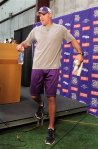 Minnesota Vikings quarterback Brett Favre steps off the dais after addressing the media during a news conference at the team's NFL football training facility in Eden Prairie, Minn., Wednesday, Nov 3, 2010. AP Photo/Andy King ....