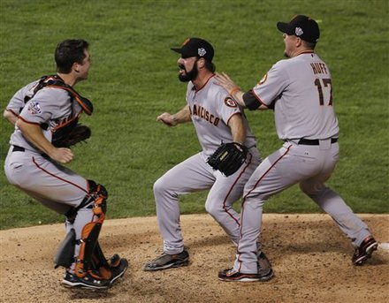 San Francisco Giants Brian Wilson celebrates with Buster Posey, left and Aubrey Huff, right after winning the World Series in Game 5 of baseball's World Series against the Texas Rangers Monday, Nov. 1, 2010, in Arlington, Texas. The Giants won 3-1 to capture the series. AP Photo/Mark Humphrey .........