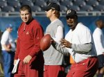 Washington Redskins quarterbacks Donovan McNabb, right, John Beck, center, and Rex Grossman attend warmups before an NFL football game against the Chicago Bears in Chicago, Sunday, Oct. 24, 2010. AP Photo/Charles Rex Arbogast .....