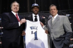 Washington Wizards first draft pick John Wall, center, from the University of Kentucky, smiles as he holds up a jersey with coach Flip Saunders, right, and Wizards president Ernie Grunfeld during a news conference in Washington . courtesy of Associated Press ......