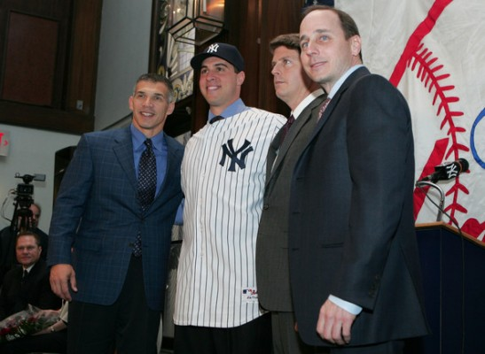 (L-R) Manager Joe Girardi, Mark Teixeira, Hal Steinbrenner and General Manager Brian Cashman pose for a photo during a press conference to announce Teixeira's signing to the New York Yankees at Yankee Stadium on January 6, 2009 in the Bronx borough of New York City. Getty Images/ Mike Strobe .......