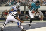Wide receiver Mike Sims-Walker (11) of the Jacksonville Jaguars makes a touchdown reception against Alan Ball (20) of the Dallas Cowboys in the first quarter at Cowboys Stadium on October 31, 2010 in Arlington, Texas. Photo by Ronald Martinez/Getty Images